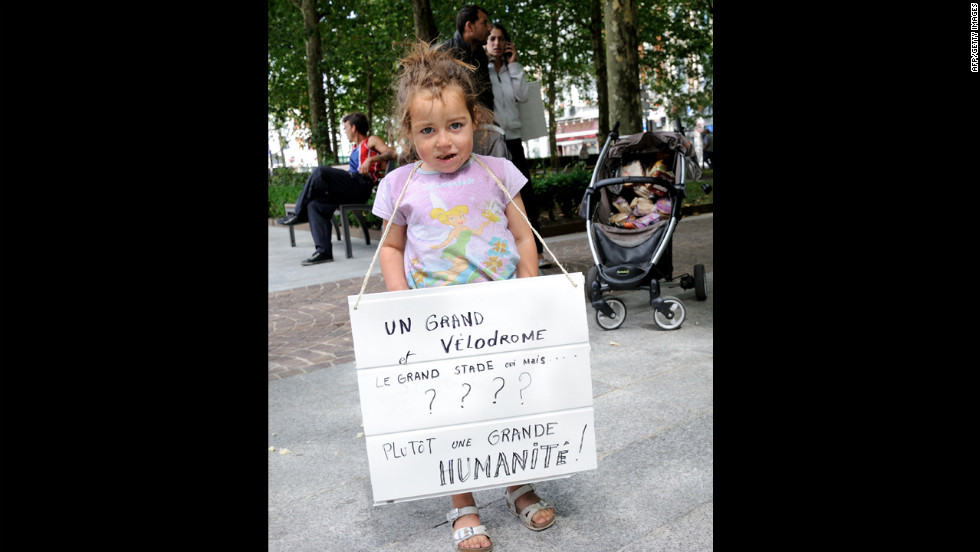 A child holds a placard during a demonstration in support of the Roma people.