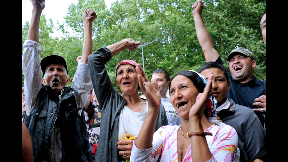 Roma take part in a demonstration Wednesday, August 22, in front of City Hall in Roubaix, northern France.