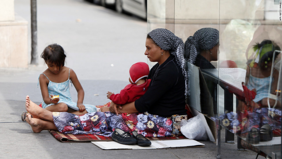 A Roma woman and her children beg at the Place de la Bastille in Paris on Wednesday, August 22.
