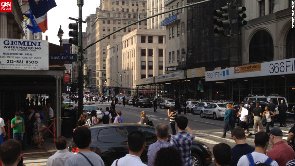 Kelly Wilson, another iReporter, captured this image of the crowd gathering near the shooting scene.