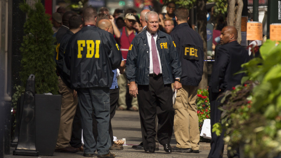 FBI authorities gather near a body outside the Empire State Building.