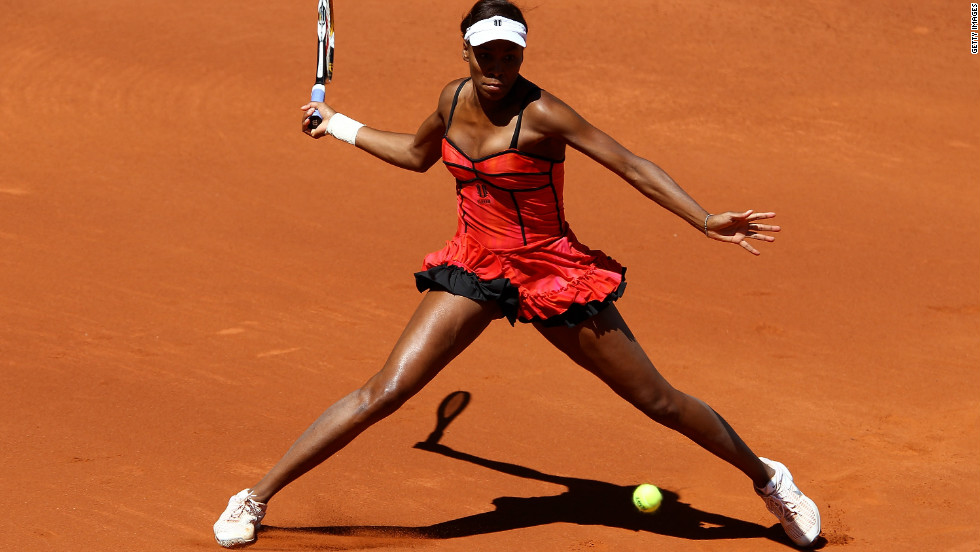 Williams lit up the clay at a WTA event in Madrid in 2010 with this risque red and black dress.
