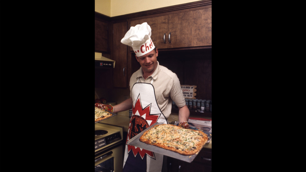 Armstrong presents a pair of pizzas in his kitchen in Houston, Texas, on March 1, 1969.