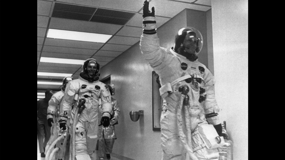 Armstrong leads crew mates Edwin 'Buzz' Aldrin and Michael Collins out of the space center on the Apollo 11 space mission to the moon.