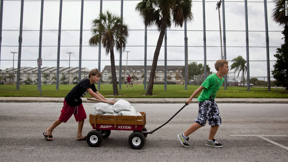 Andrew Marino, left, and Colby Collier pull a wagon filled with sandbags back to their homes as Florida residents prepared for Tropical Storm Isaac in St. Pete Beach, Florida, on Sunday.