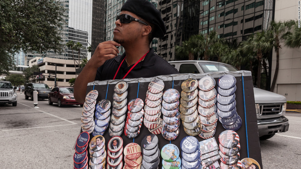 Mark Anthoney sells buttons for Mitt Romney supporters on Sunday, August 26.
