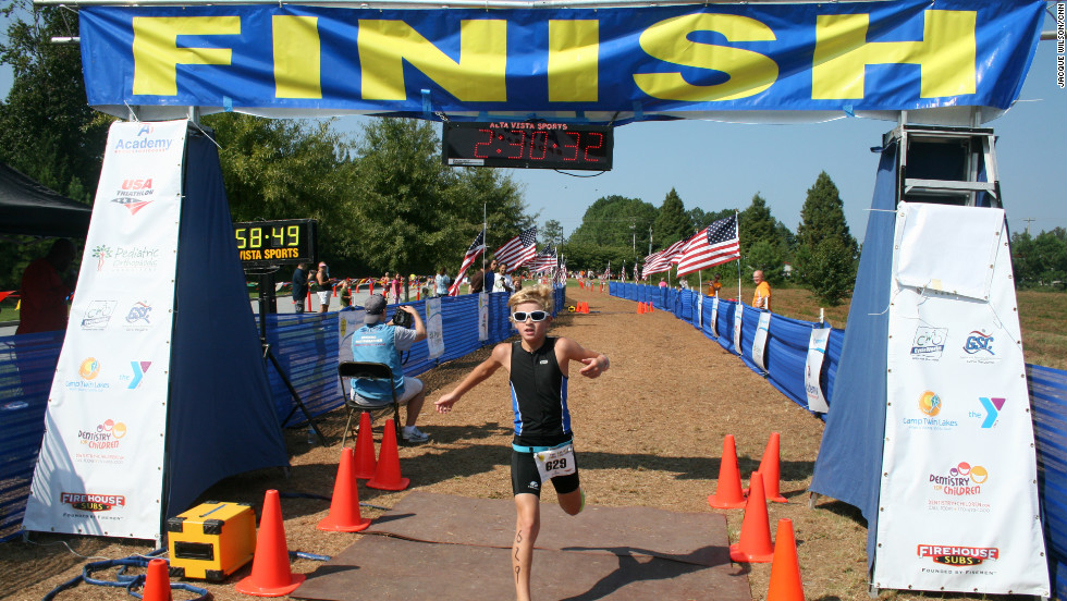 Kennan Milford, 10, crosses the finish line ahead of the rest of his group.