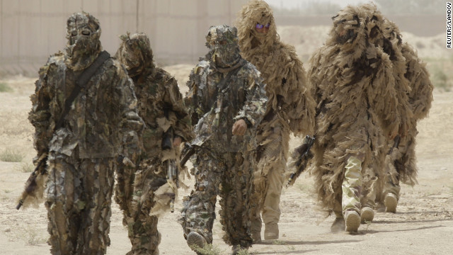 Ghillie suits -- camouflage outfits designed to resemble heavy foliage -- are worn by special operations soldiers in Iraq in 2009.
