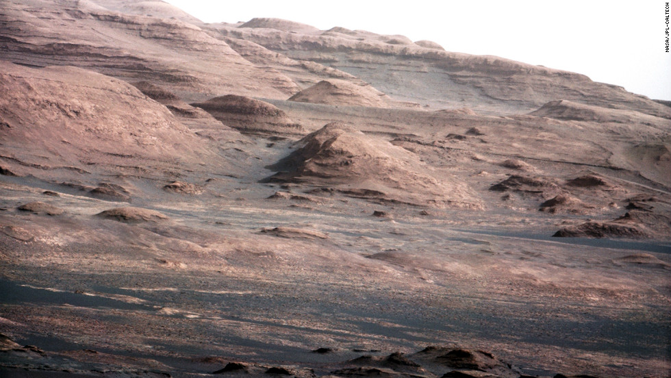 "An image released August 27, 2012, was taken with Curiosity rover's 100-millimeter mast camera, NASA says. The image shows ""Mount Sharp"" on the Martian surface. NASA says the rover will go to this area."