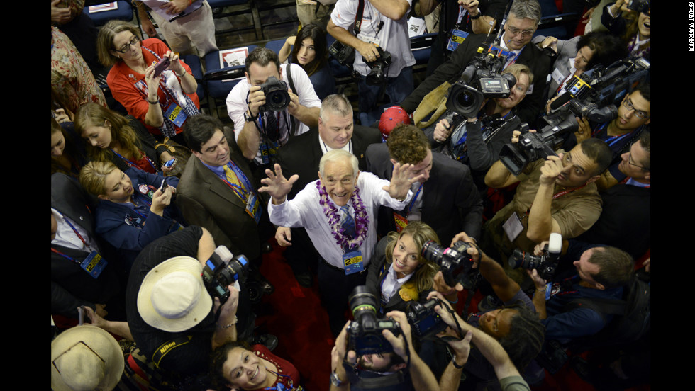 Republican candidate Ron Paul waves to supporters at the Tampa Bay Times Forum.