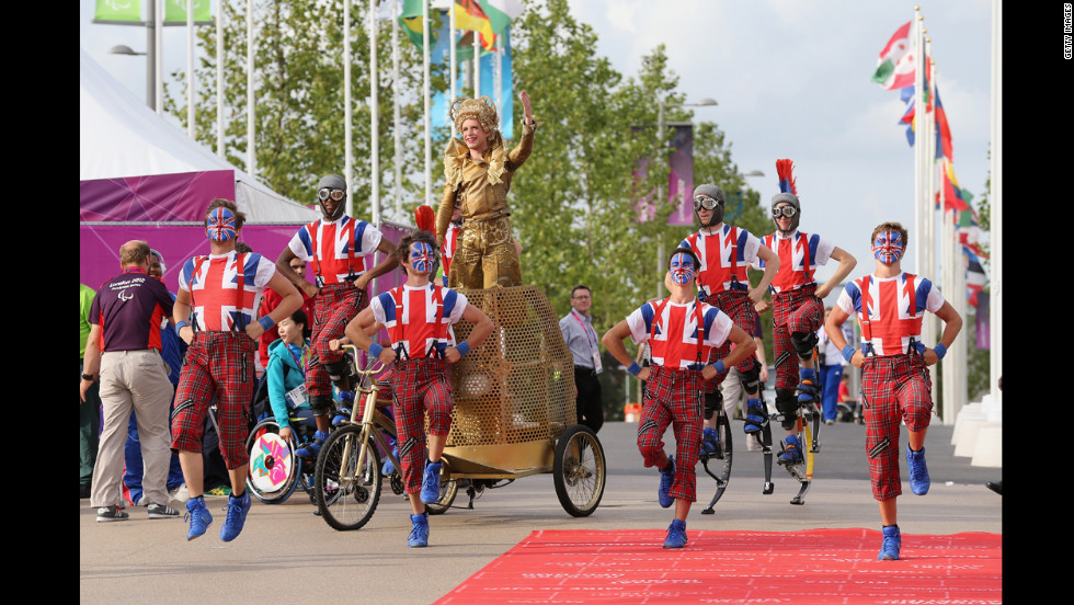 Dancers perform during a welcome ceremony at the Paralympic Village.