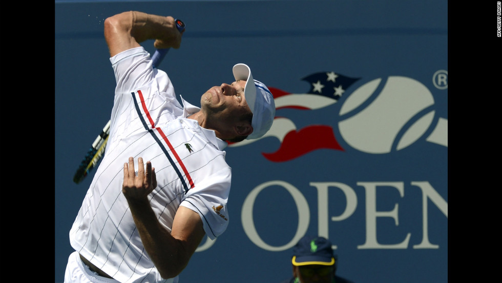 American Andy Roddick hits the ball against countryman Rhyne Williams during their first-round 2012 U.S. Open match in New York on Tuesday, August 28.
