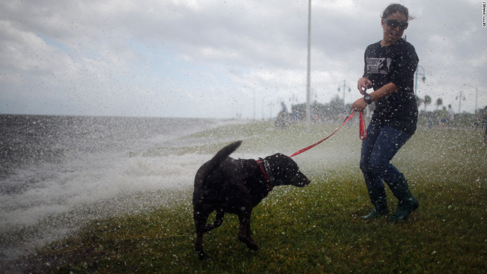 A woman and her dog watch the waves produced by Hurricane Isaac on the shore of Lake Pontchatrain in New Orleans on Tuesday. Hurricane Isaac is expected to make landfall later tonight along the Louisiana coast.