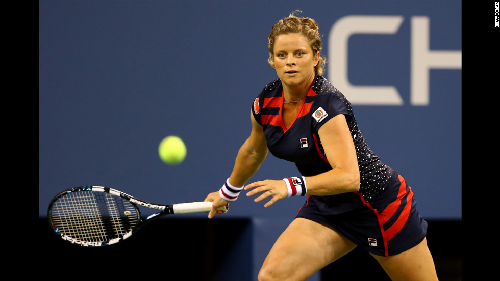 Belgium's Kim Clijsters moves to return a shot during her women's singles first-round match against American Victoria Duval.