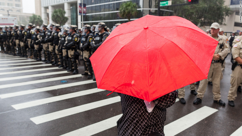 Tampa security forces line up to block a small group of demonstrators on Monday, August 27.