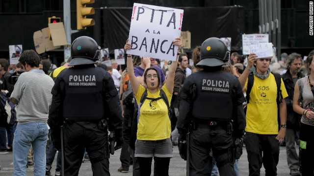 A woman holds a poster reading 'Lets boo the banks' at a Barcelona protest in May.