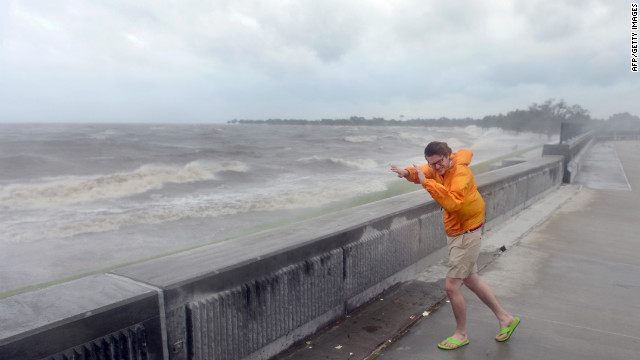 "Evan Stoudt faces strong winds while visiting the banks of Lake Pontchartrain in New Orleans on August 28, 2012 in Louisiana, where Hurrican Isaac has made landfall.  The US National Hurricane Center said a ""dangerous storm surge"" was occuarring along the northern Gulf Coast with storm surges of up to eight feet (2.4 meters) already being reported in Louisiana, Mississippi and Florida.  States of emergency have been declared in Louisiana and Mississippi, allowing authorities to coordinate disaster relief and seek emergency federal funds. AFP PHOTO / Frederic J. BROWN        (Photo credit should read FREDERIC J. BROWN/AFP/GettyImages)"