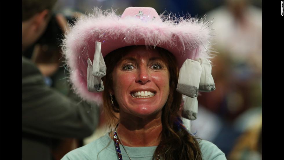 Leslie Jones of Virginia Beach, Virginia, wears a hat with tea bags attached.