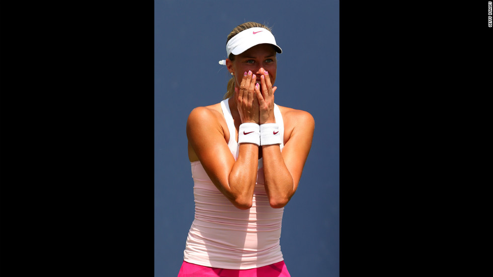 Andrea Hlavackova of the Czech Republic celebrates after defeating Klara Zakopalova, also of the Czech Republic, in the first round.