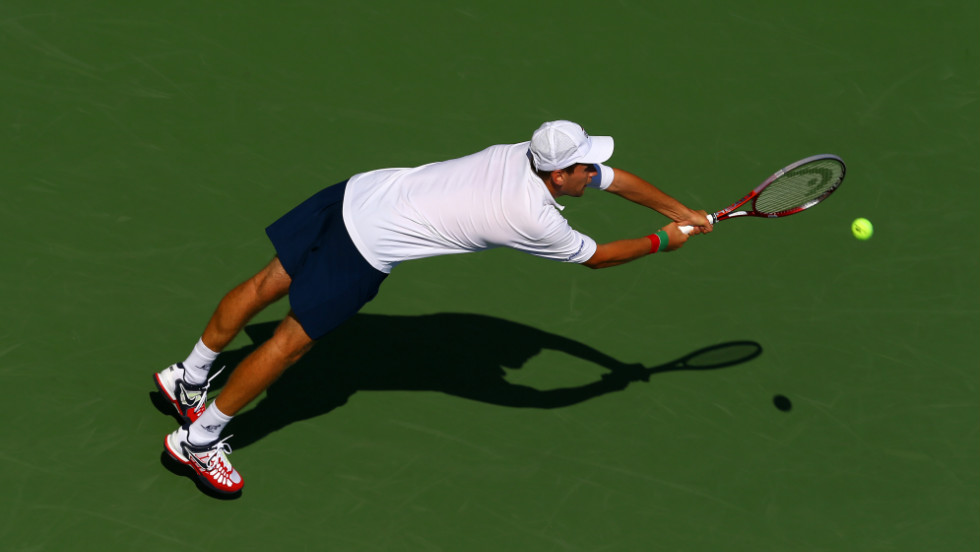 Slovakia's Karol Beck stretches to return a backhanded shot against France's Jo-Wilfried Tsonga.