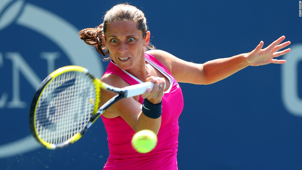 Italy's Roberta Vinci returns a shot against Poland's Urszula Radwanska.