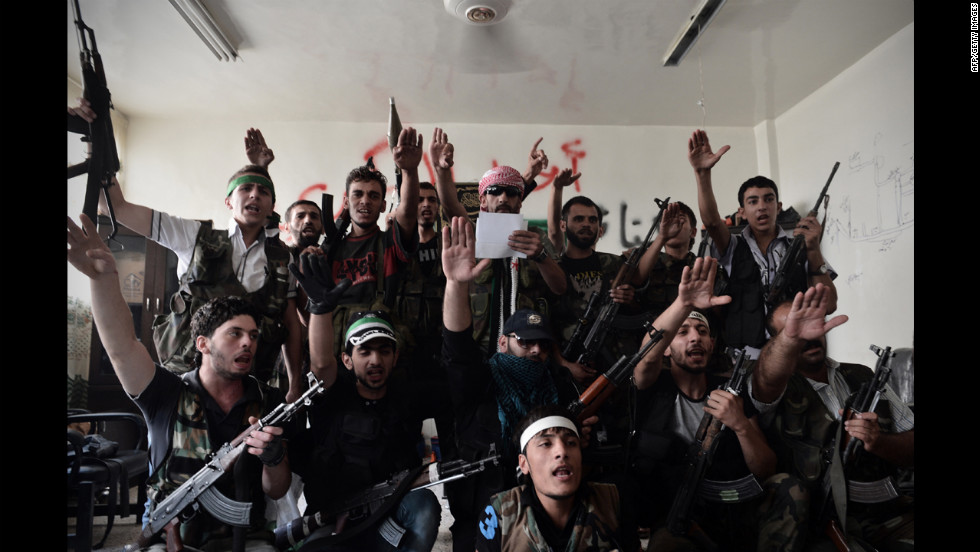 Syrian opposition fighters swear an oath for the liberation of Syria in Aleppo on Wednesday.