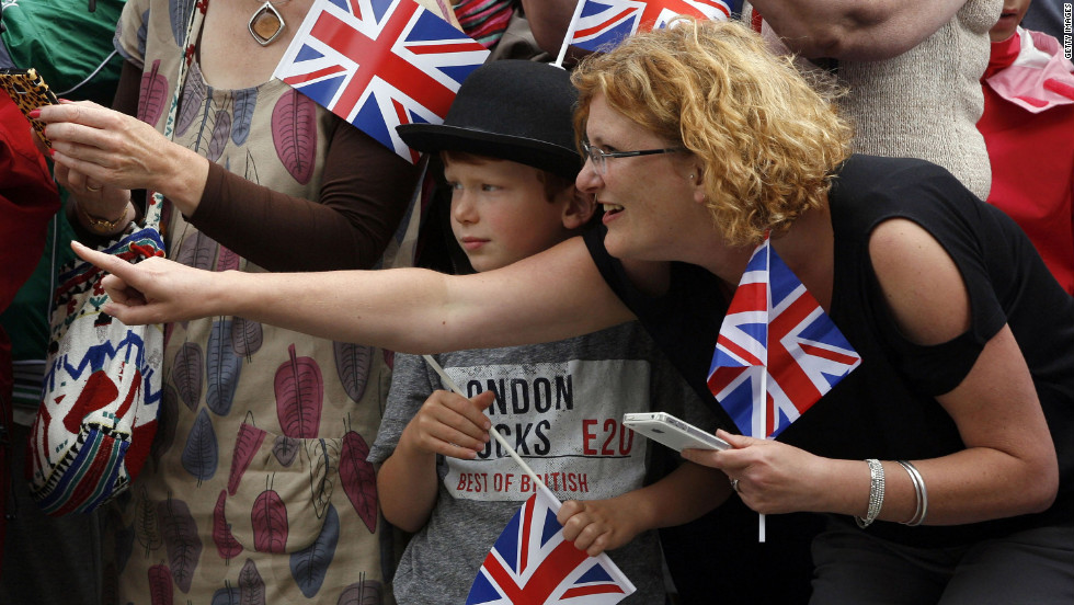A young boy waits for the arrival of the Paralympic torch in Trafalgar Square ahead of the start of the Games.