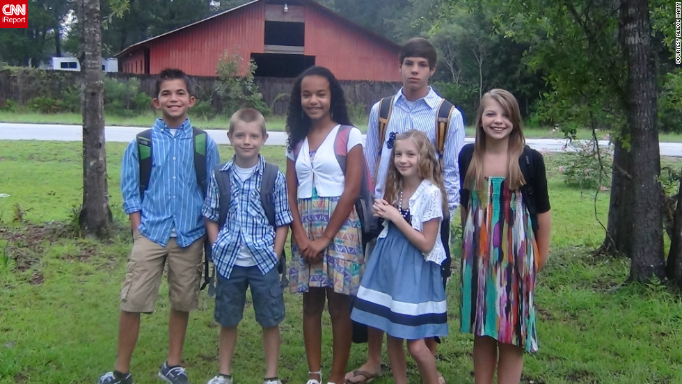 The brand new school year for the Hamm family was twice as sweet, with two children each in elementary, middle and high school.  Picking out their first day of school outfits two weeks in advance, the six children were paired together as they set off for their schools in Brunswick, Georgia.