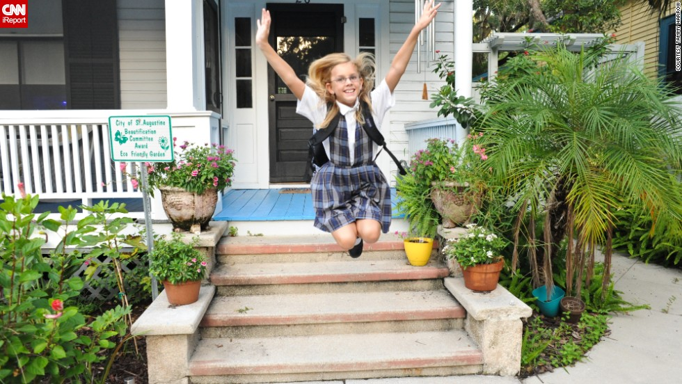 Jumping for joy on her first day of fourth grade, Tammy Harrow says her daughter Jordan was dressed in her uniform an hour before she had to get up.