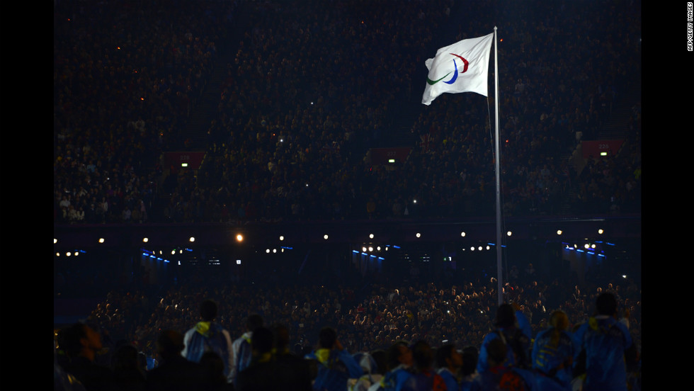 The Paralympic flag is raised.