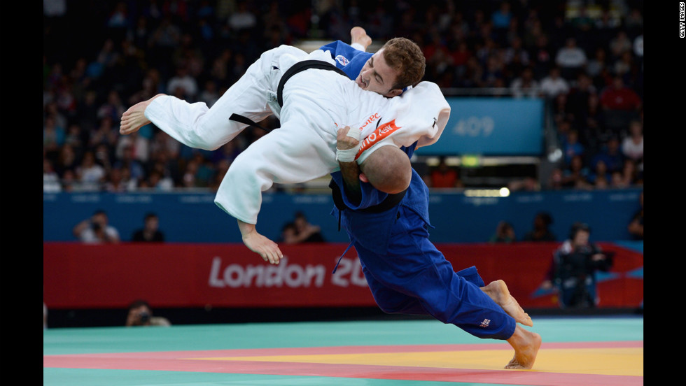 Ben Quilter, in white, of Great Britain competes against Mouloud Noura of Algeria during the men's -60 kilogram judo quarterfinal match.