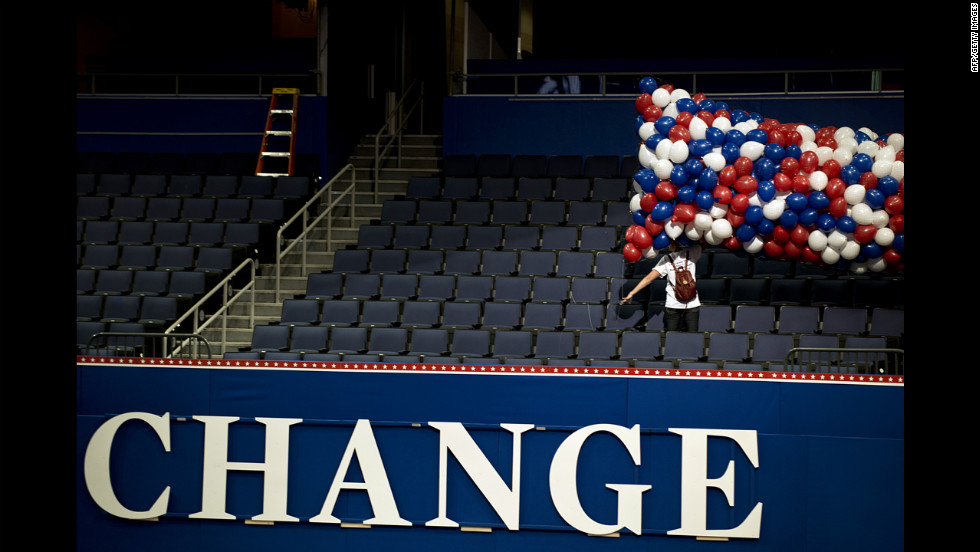 A worker carries a net of balloons to decorate the Tampa Bay Times Forum on Friday, August 24, for the Republican National Convention.
