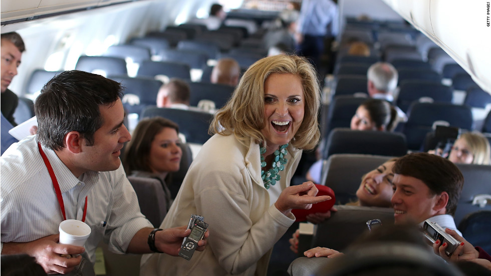 Ann Romney delivers Welsh cakes to members of the traveling press aboard the campaign plane on Tuesday, August 28, en route to Tampa, Florida.