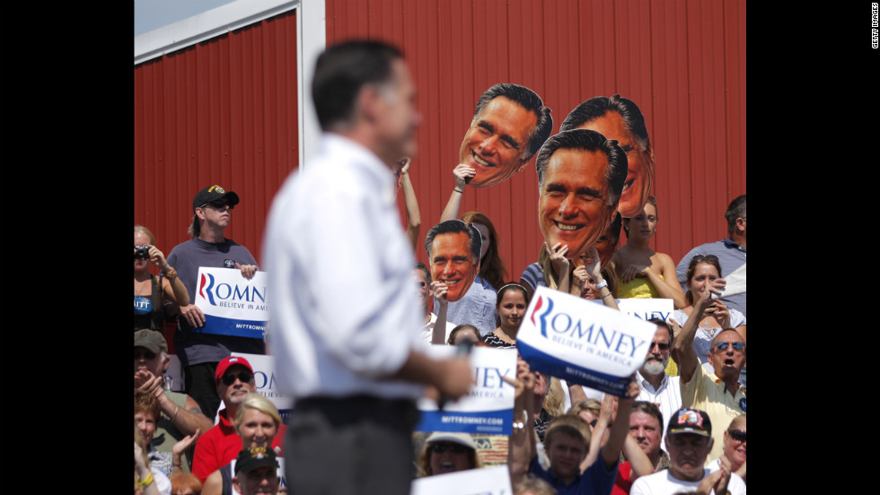 Romney attends a victory rally at the Long Family Orchard Farm and Cider Mill on Friday, August 24, in Commerce, Michigan. Romney's wife, Ann, and his running mate, Ryan, also spoke at the event.