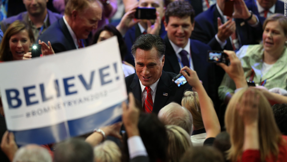 Romney greets supporters as he enters the arena Thursday.
