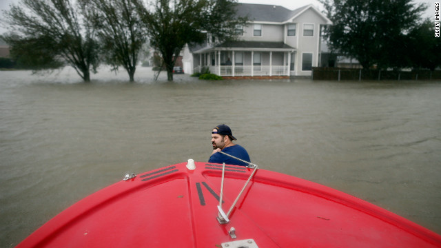 Henry Cox pulls his boat while rescuing residents from the floodwaters of Hurricane Isaac in LaPlace, Louisiana.