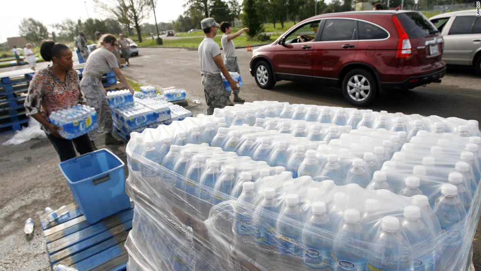 Members of the Louisiana Army National Guard and Louisiana Air National Guard distribute water, MREs and ice at Skelly-Rupp Stadium in New Orleans on Friday.