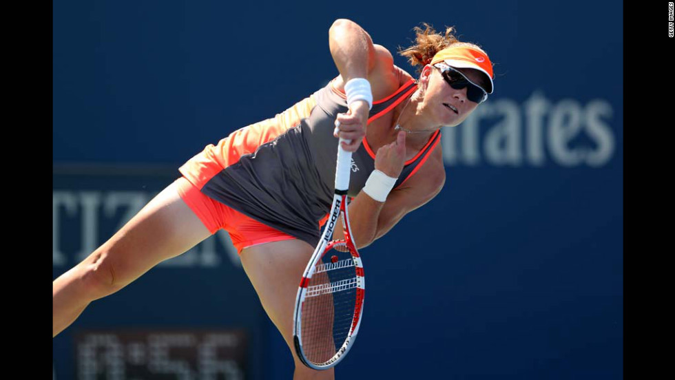 Samantha Stosur of Australia serves against Varvara Lepchenko of the United States during a women's singles third round match.