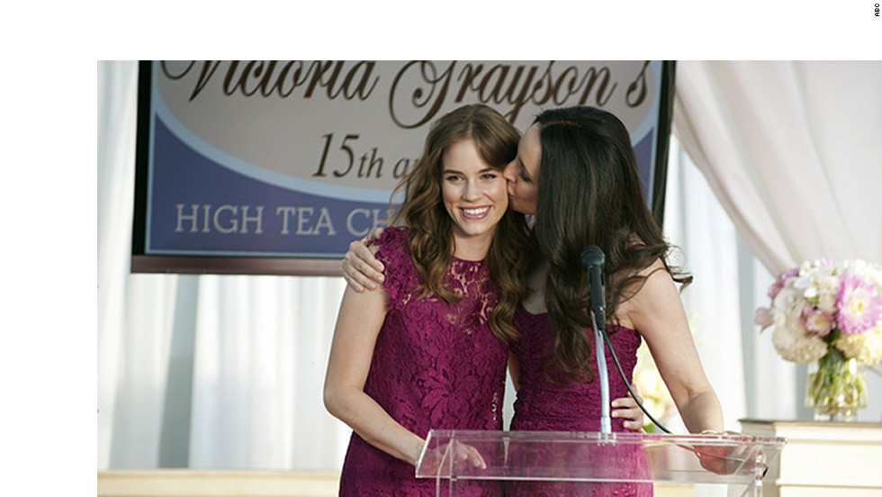 "Charlotte, left, and Victoria Grayson wore these raspberry lace Dolce & Gabbana dresses to attend ""a fancy mother/daughter tea,"" Ohanneson said. ""I had already purchased Victoria's dress for her closet when I got the script, and I remembered that D&G had a shorter shift dress in the same fabric, which we added a ruffled cap sleeve to (for Charlotte)."""