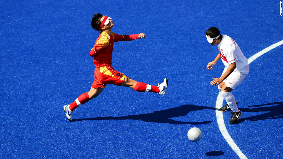 Chinese Zhoubin Wang, left, chases the ball during the men's team football five-a-side match against Turkey.