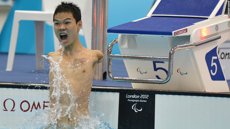 China's Zheng Tao celebrates breaking the world record after winning the men's 100-meter backstroke swimming event.