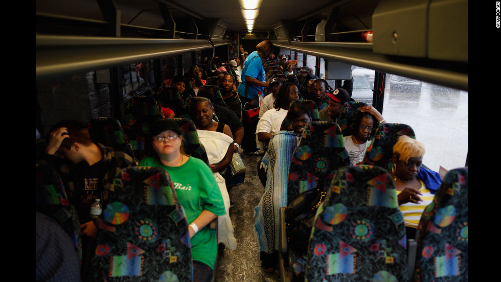 Residents sit on a bus Thursday after evacuating Laplace, Louisiana.