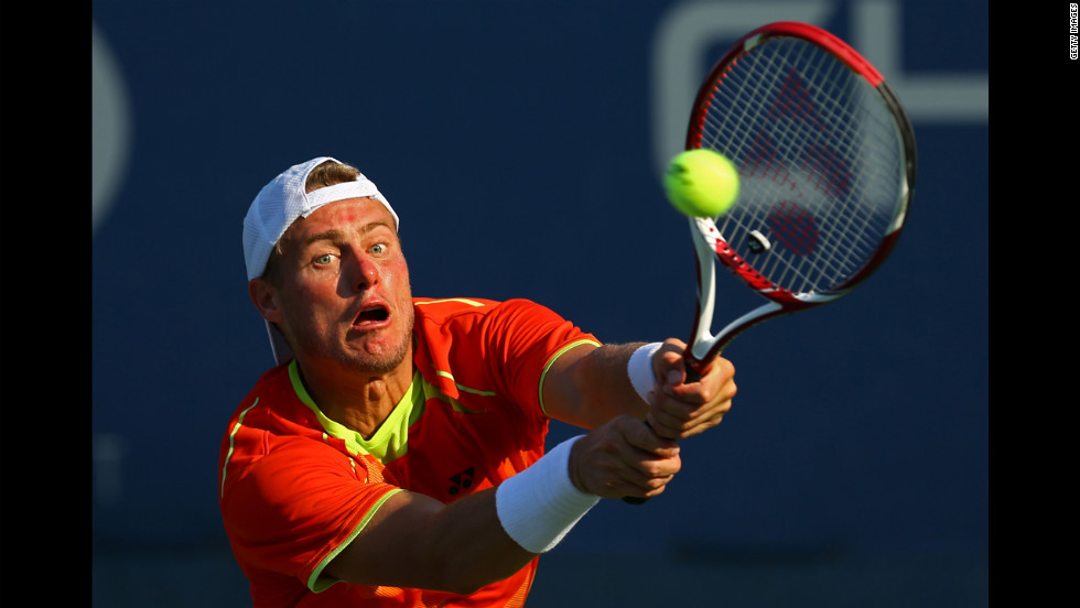Australia's Lleyton Hewitt returns a shot to Luxembourg 's Gilles Muller in a men's singles second-round match.