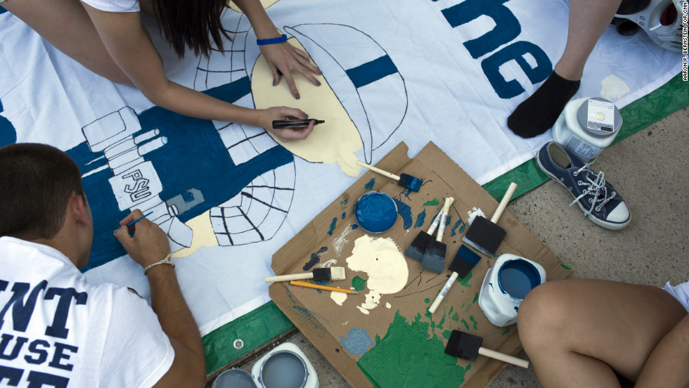 "Penn State students work on a banner at ""Nittanyville"" outside Beaver Stadium in State College, Pennsylvania, on Friday, August 31."