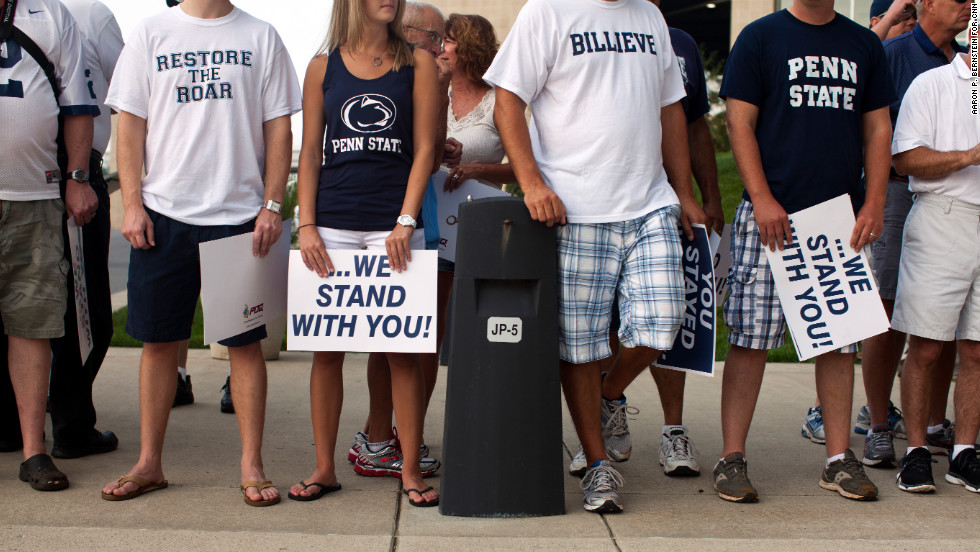 Penn State fans await the arrival of the football team.