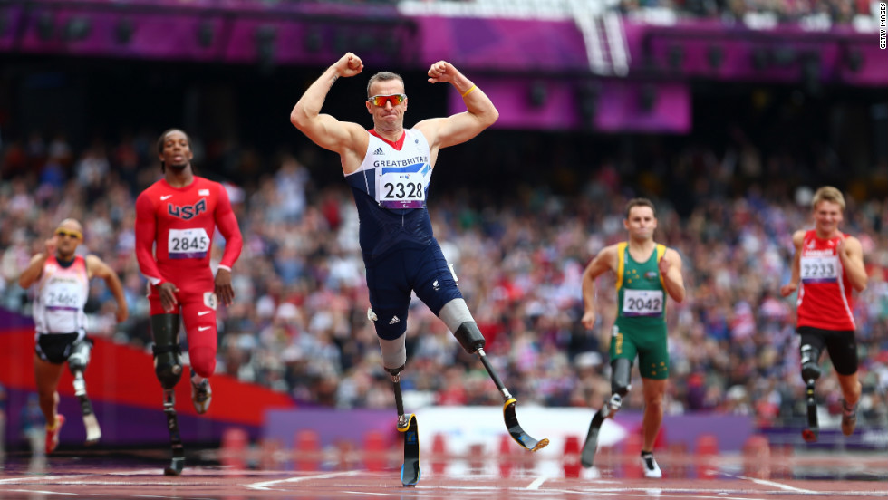 Richard Whitehead of Great Britain celebrates winning gold in the men's 200-meter T42 final.