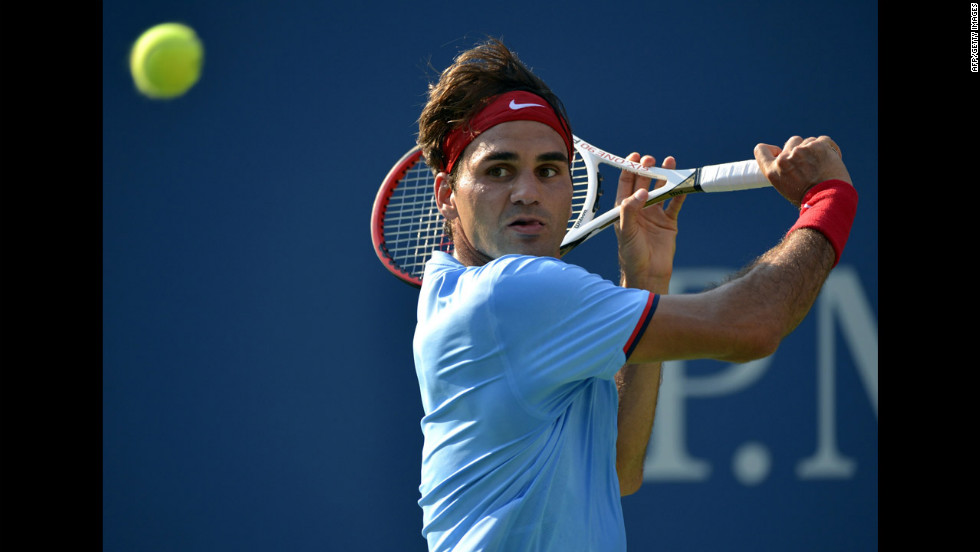 Switzerland's Roger Federer returns a shot to Spain's Fernando Verdasco.