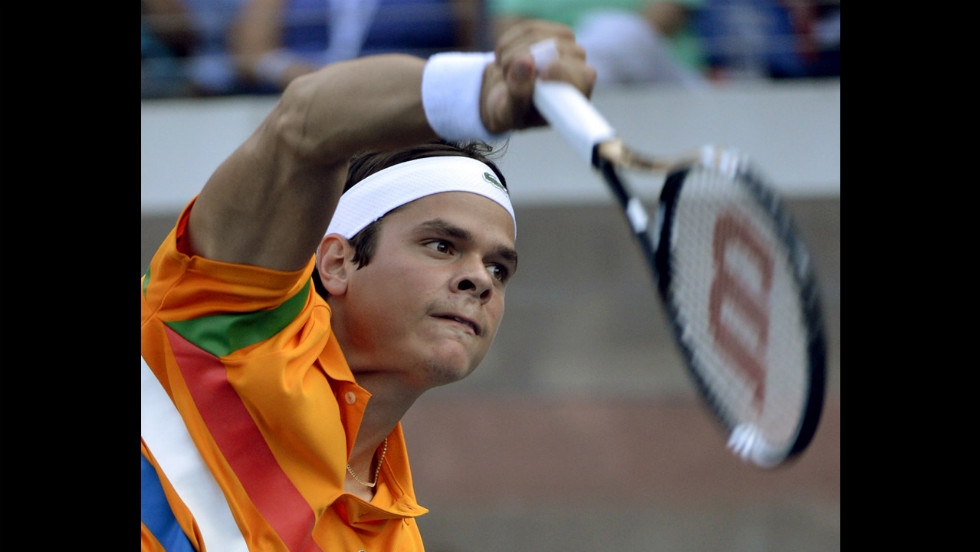 Milos Raonic of Canada serves in his match against James Blake of the United States.