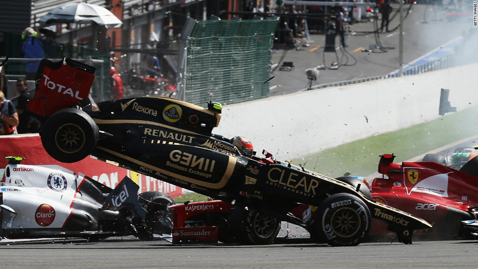 Grosjean in the Lotus has cleared Alonso's front wing and is about the come to ground.