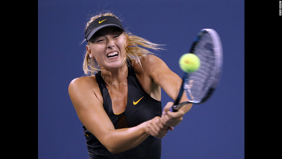 Russia's Maria Sharapova returns a shot to Nadia Petrova of Russia and wins Sunday's match to move on to the quarterfinals.